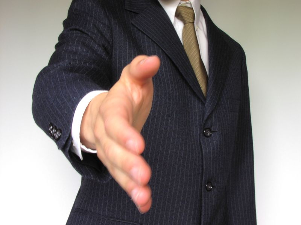 1720-business-man-offering-hand-shake-pv.jpg