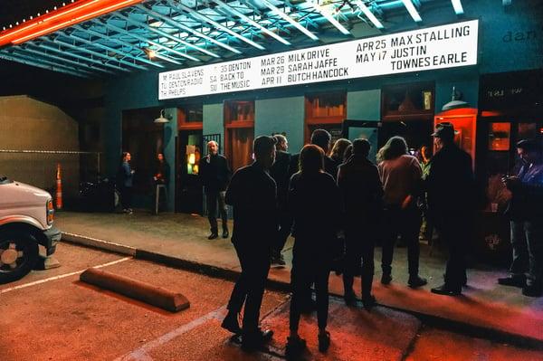 A crowd gathers outside a Denton Texas music venue.jpg