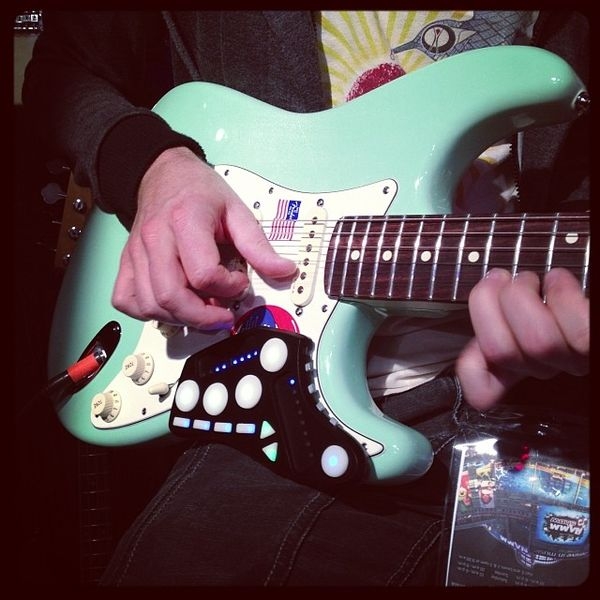 Livid_Guitar_Wing_-_A_3D_wireless_controller_for_guitar_and_bass_-_attached_on_Fender_Stratocaster_-_Fender_booth_2014_NAMM_Show__by_Livid_Instruments.jpg