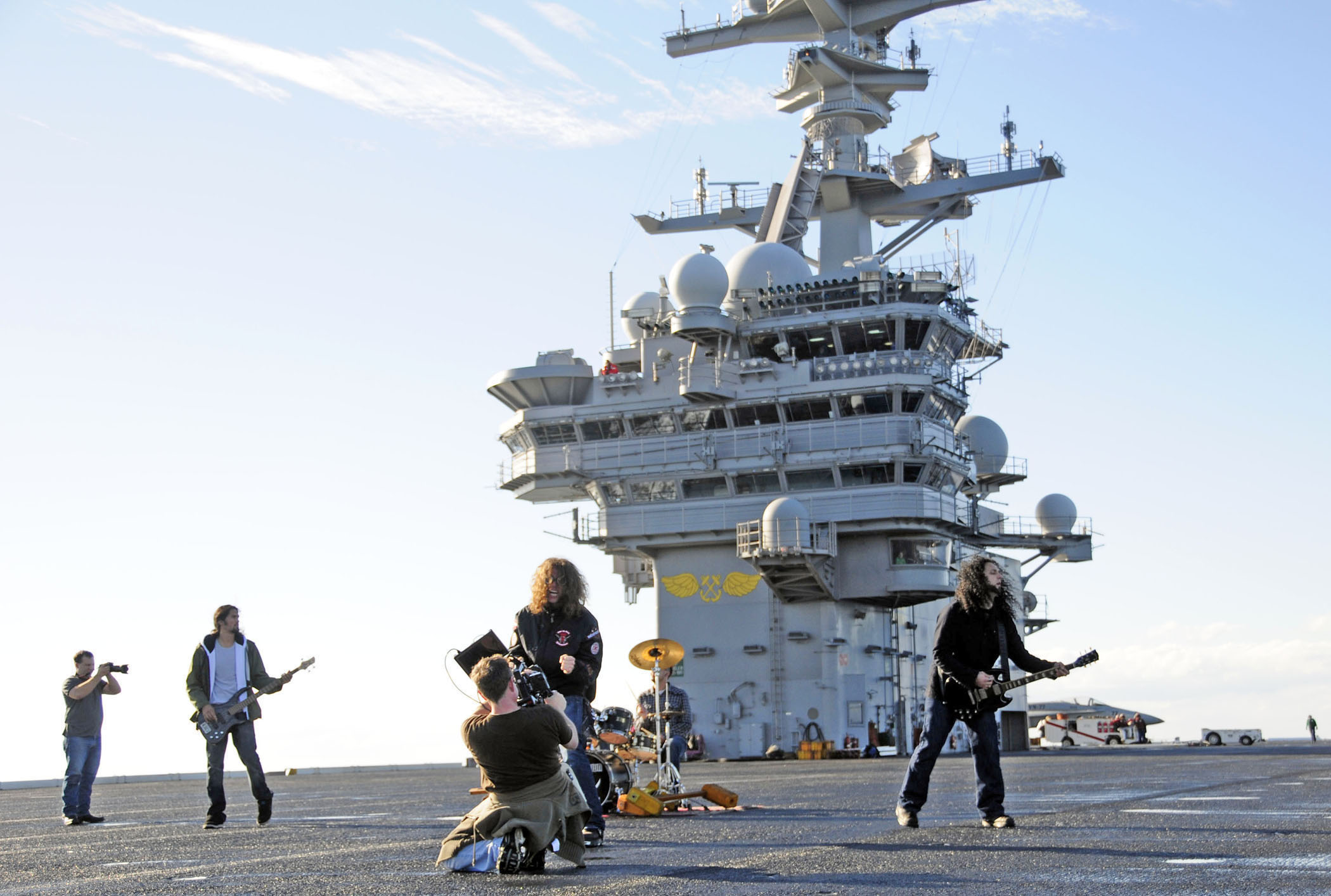 US_Navy_101201-N-8913A-254_Members_of_the_North_Carolina-based_band_Airiel_Down_film_a_music_video_on_the_flight_deck_of_the_aircraft_carrier_USS_G.jpg
